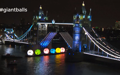 Giant National Lottery Balls sail down the River Thames