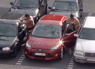 Two Sumo Wrestlers try to get into a Ford Focus
