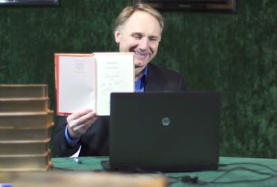 Dan Brown signs his books online