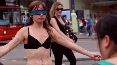 Girl Undresses in Public for Courageous Cause