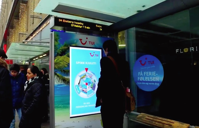 Interactive wheel of fortune bus shelter for TUI
